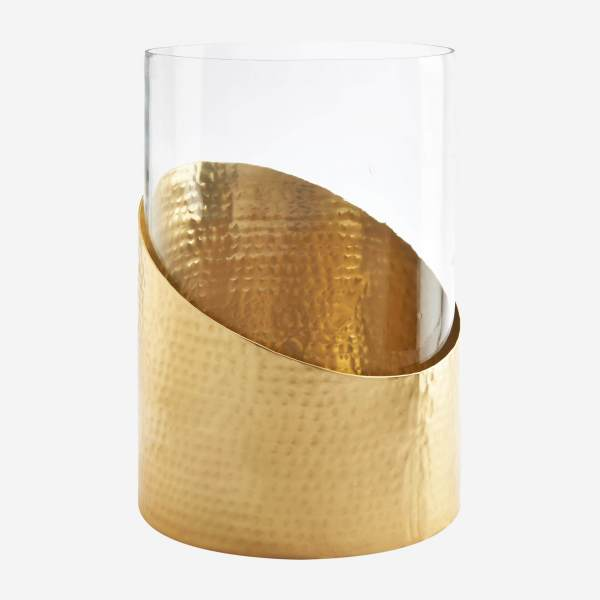 Candle holder made of hammered metal and glass