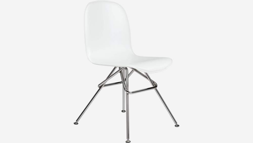 Chair with white faux leather cover and chrome steel legs