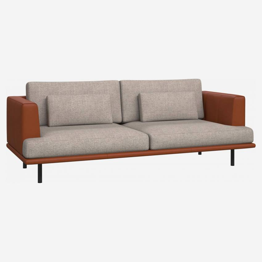 3 seater sofa in Lecce fabric, nature with base and armrests in brown leather