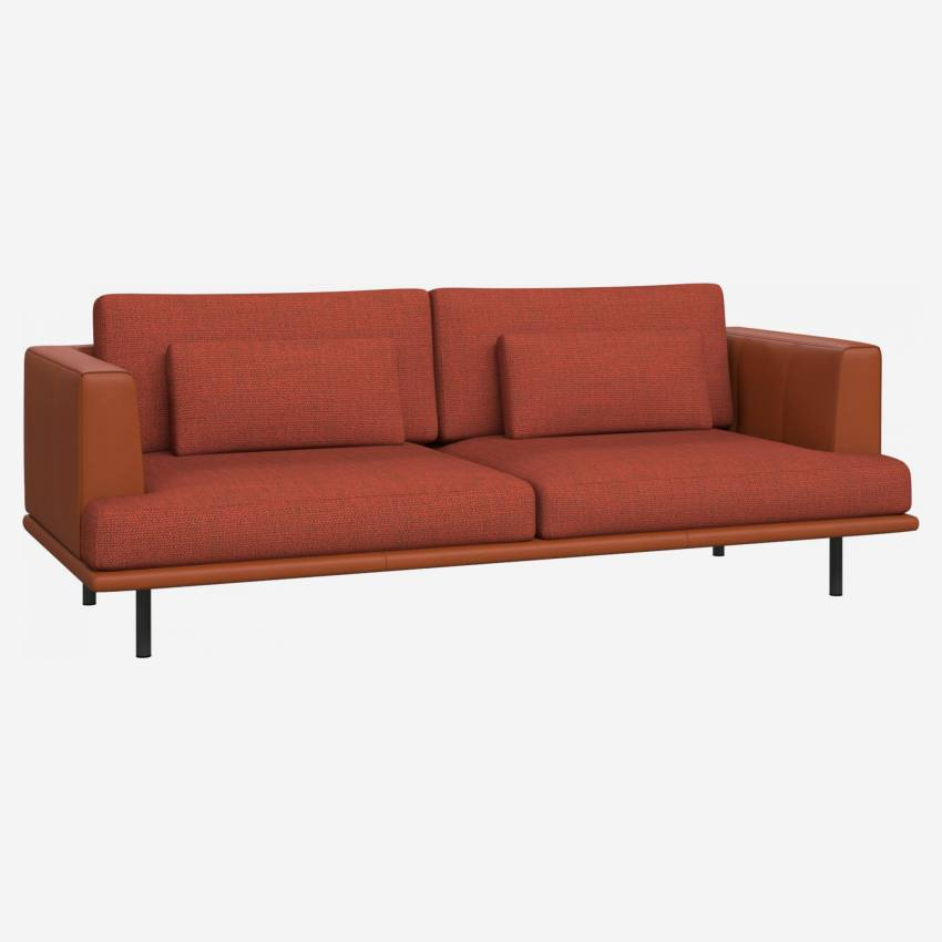 3 seater sofa in Fasoli fabric, warm red rock with base and armrests in brown leather