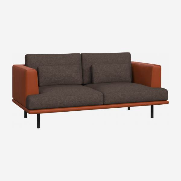 2 seater sofa in Lecce fabric, muscat with base and armrests in brown leather