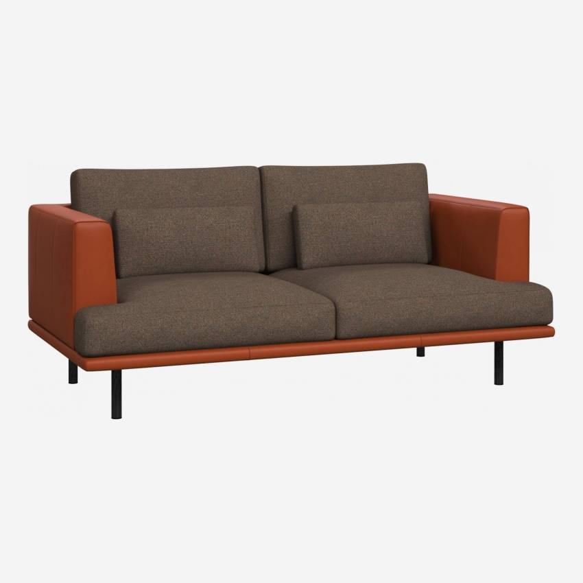 2 seater sofa in Lecce fabric, burned orange with base and armrests in brown leather