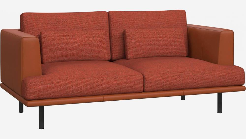 2 seater sofa in Fasoli fabric, warm red rock with base and armrests in brown leather