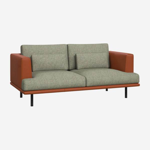 2 seater sofa in Bellagio fabric, organic green with base and armrests in brown leather