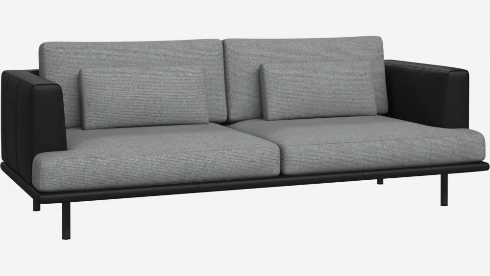 3 seater sofa in Lecce fabric, blue reef with base and armrests in black leather