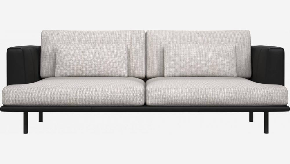 3 seater sofa in Fasoli fabric, snow white with base and armrests in black leather