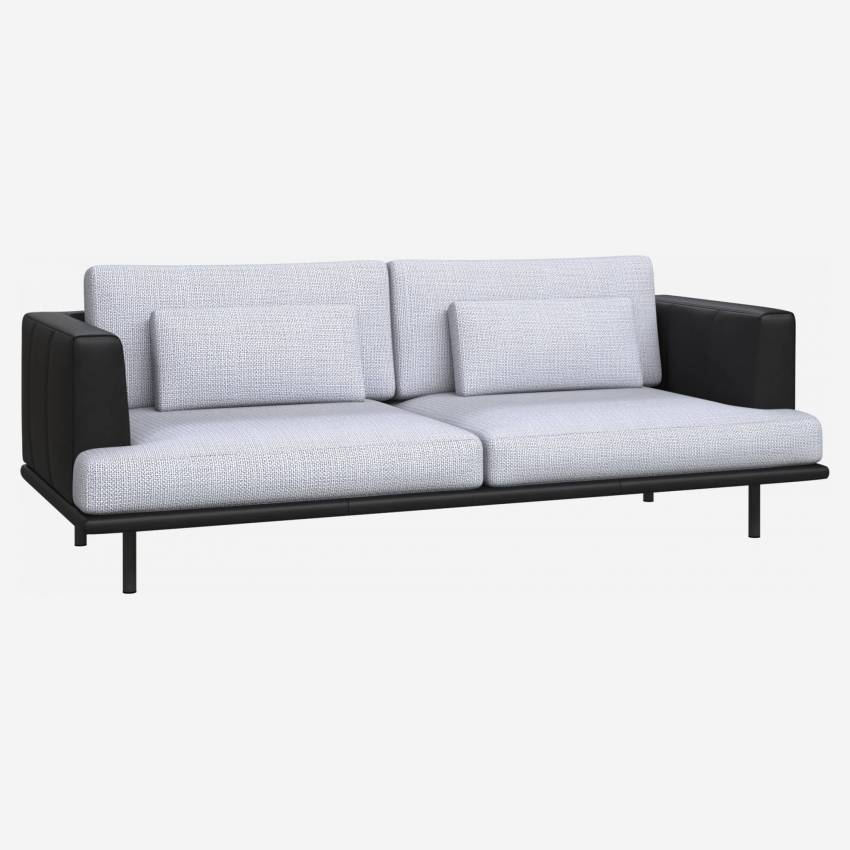3 seater sofa in Fasoli fabric, grey sky with base and armrests in black leather