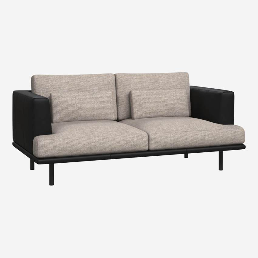 2 seater sofa in Lecce fabric, nature with base and armrests in black leather