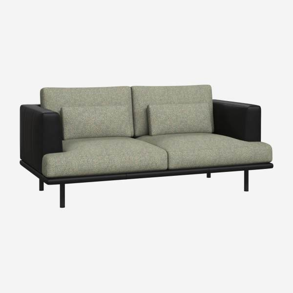 2 seater sofa in Bellagio fabric, organic green with base and armrests in black leather