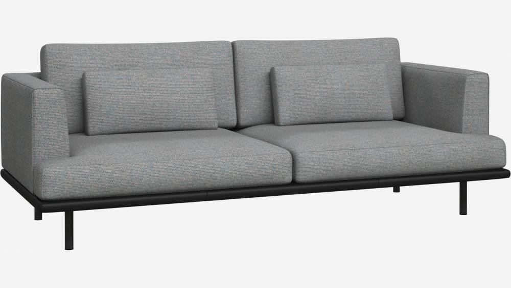 3 seater sofa in Lecce fabric, blue reef with base in black leather