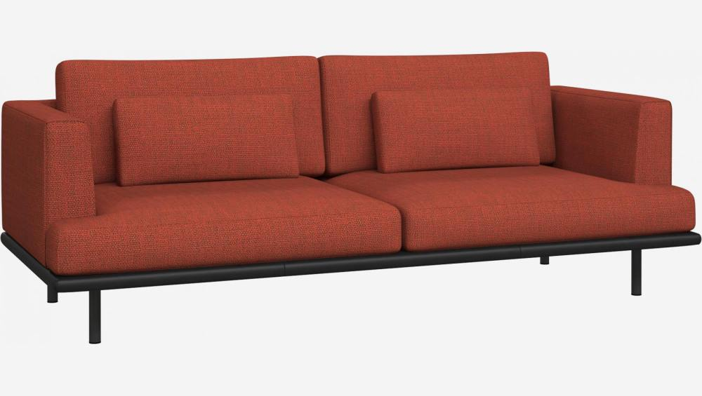 3 seater sofa in Fasoli fabric, warm red rock with base in black leather