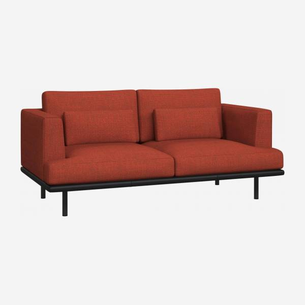 2 seater sofa in Fasoli fabric, warm red rock with base in black leather
