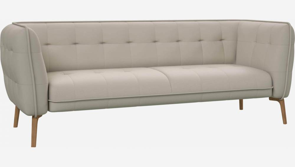 3 seater sofa in Eton veined leather, cream and natural oak feet