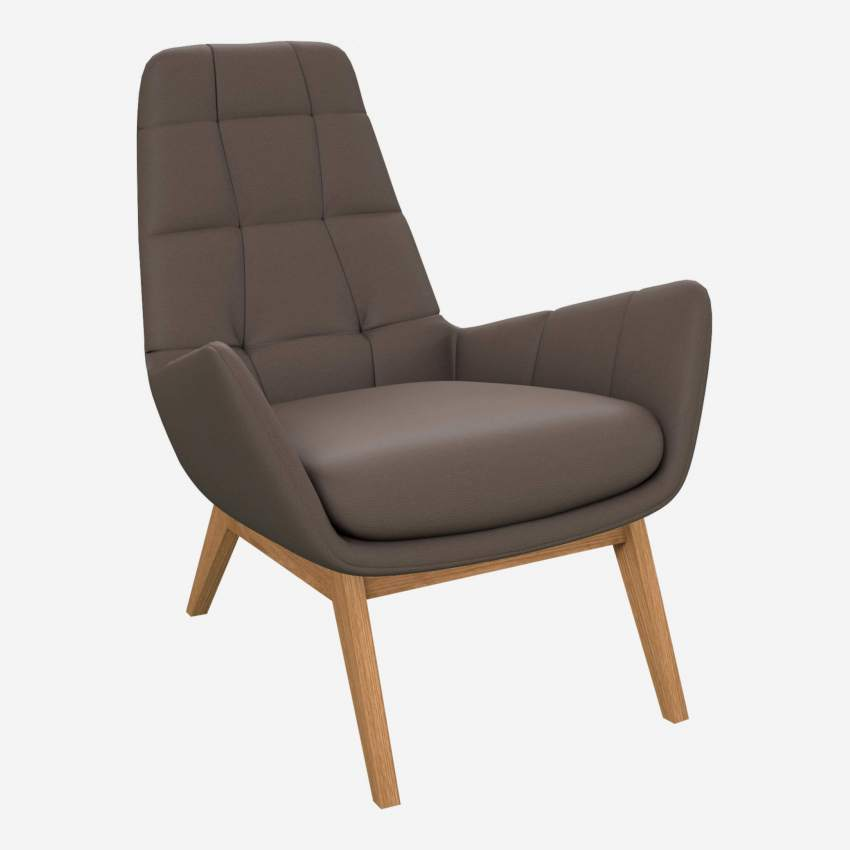 Armchair in Eton veined leather, stone with oak legs