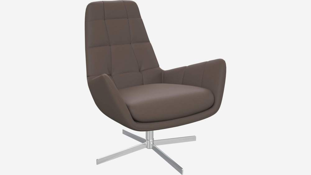 Armchair in Eton veined leather, stone with metal cross leg