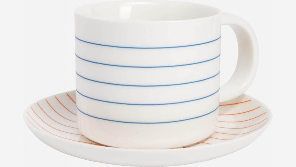 Tea cup et soucoupe made of porcelain, with red stripes