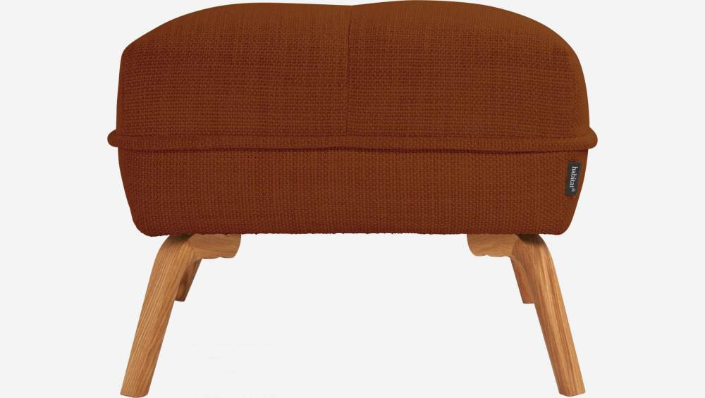Footstool in Fasoli fabric, warm red rock and oak legs