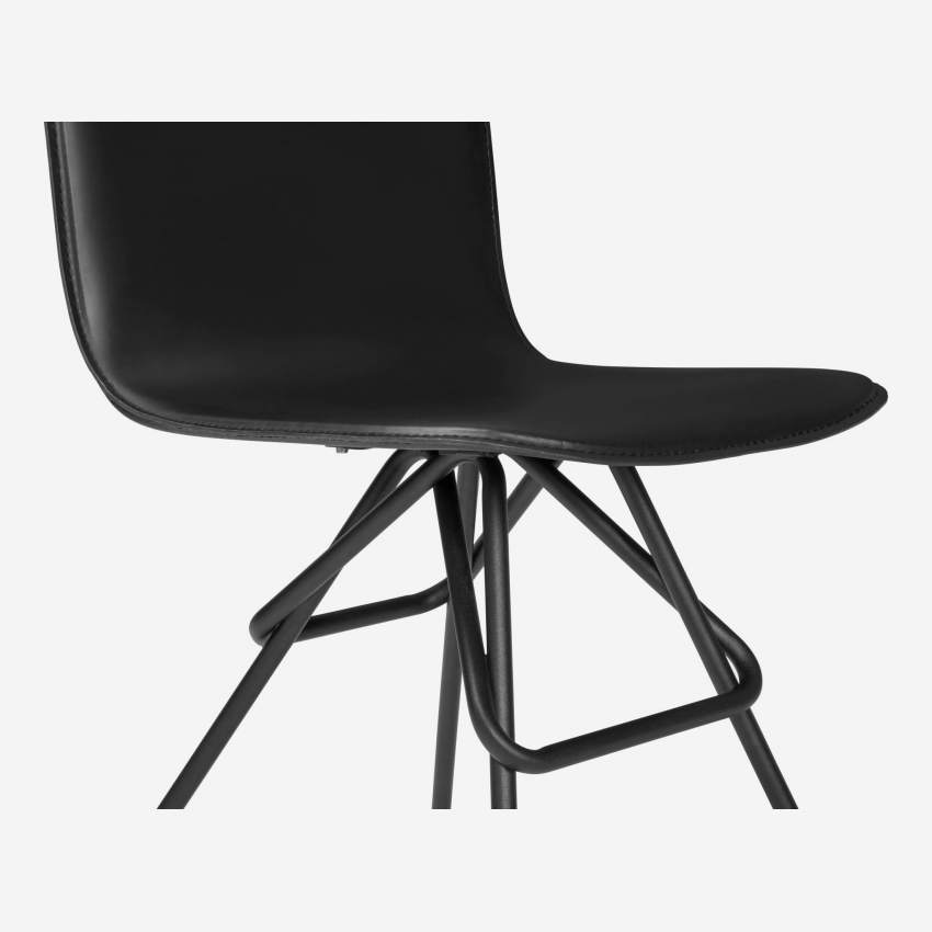 Chair with black faux leather cover and black steel legs