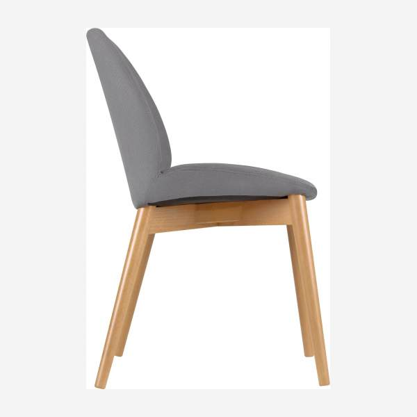 Chair with grey fabric cover and beech wood legs