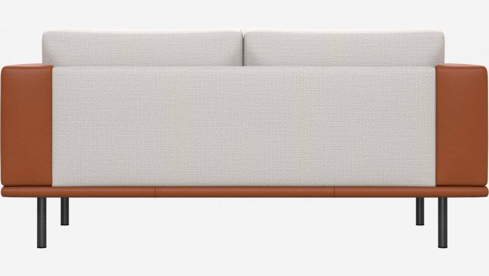2 seater sofa in Fasoli fabric, snow white with base and armrests in brown leather