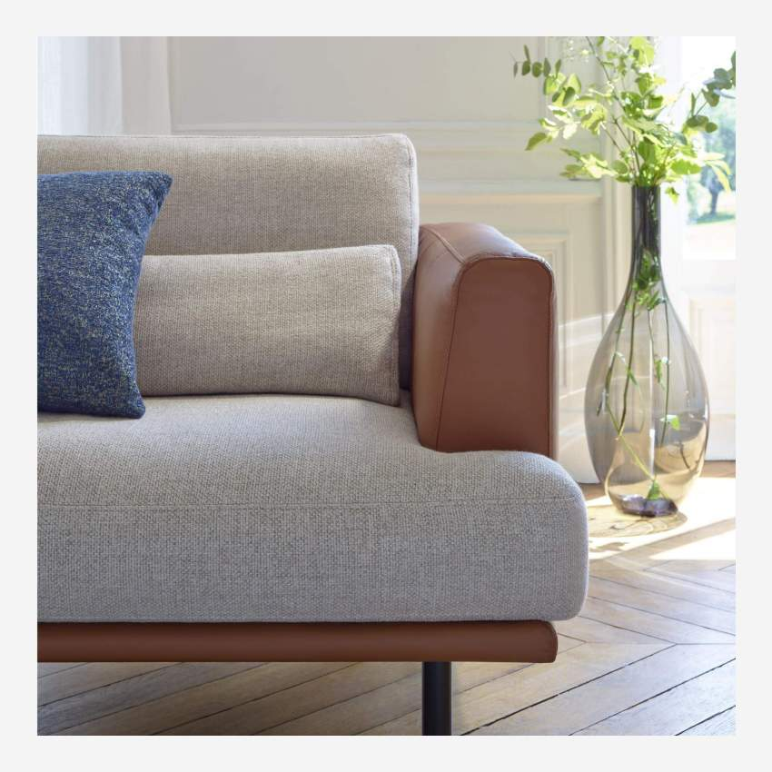 2 seater sofa in Fasoli fabric, grey sky with base and armrests in brown leather