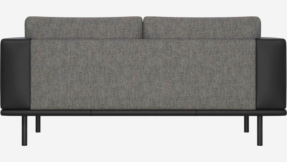 2 seater sofa in Bellagio fabric, night black with base and armrests in black leather
