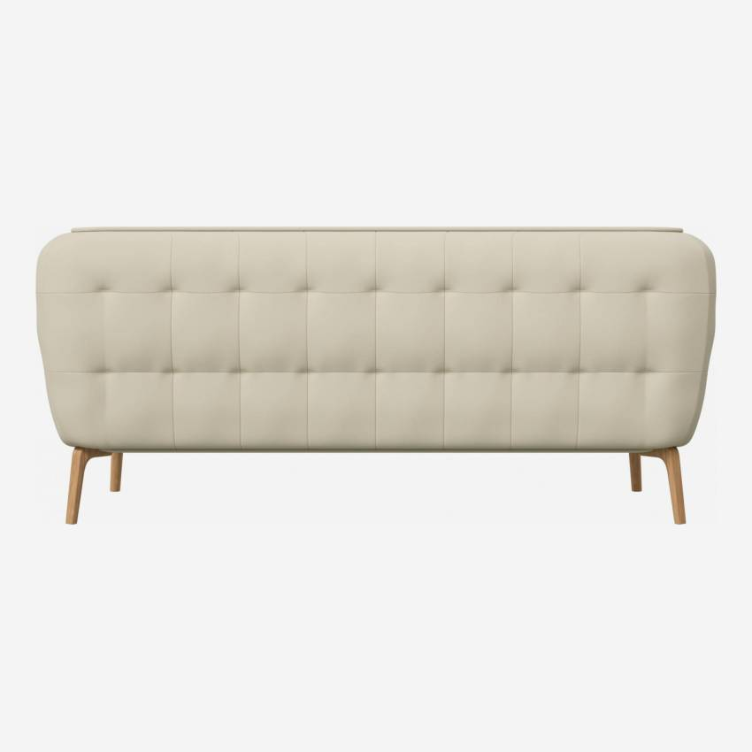 2 seater sofa in Savoy semi-aniline leather, off white and natural oak feet