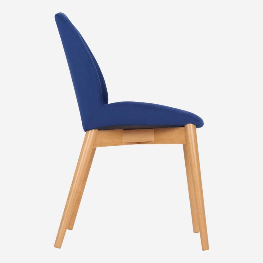 Chair with blue fabric cover and beech wood legs
