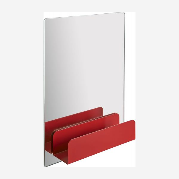 a mirror with a shelf and hooks