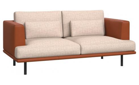 2 seater sofa in Ancio fabric, nature with base and armrests in brown leather